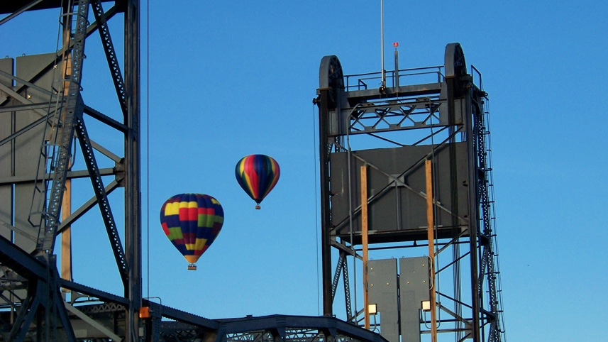 Two hot air balloons over the Stillwater Lift Bridge. Courtesy Aamodt's Balloons.