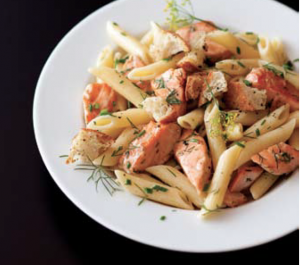 A plate of penne rigate with salmon and fiery vodka