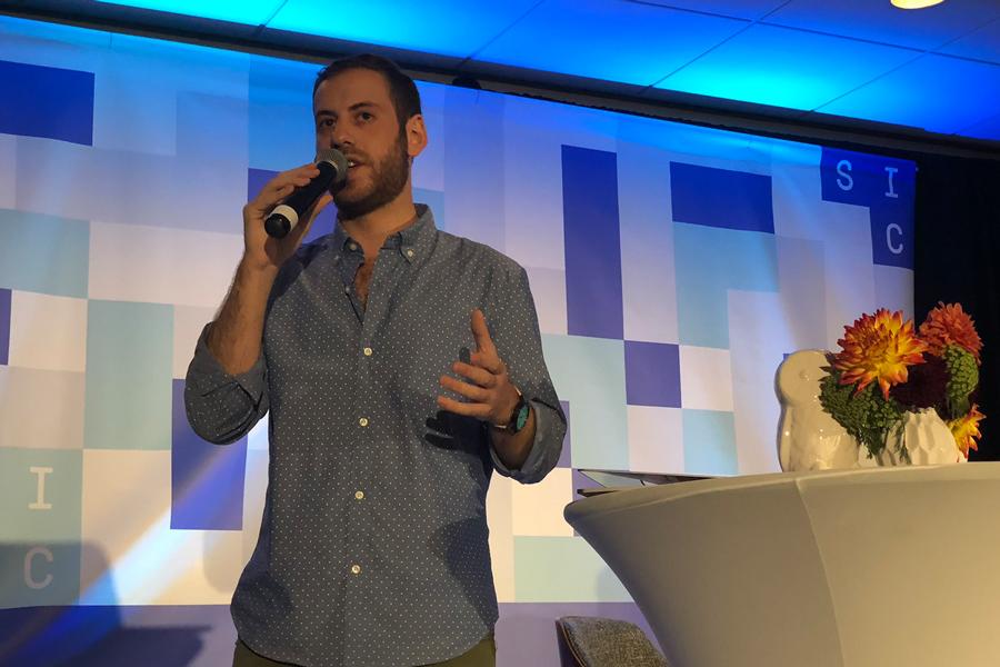 Jon Savitt speaking at a conference.