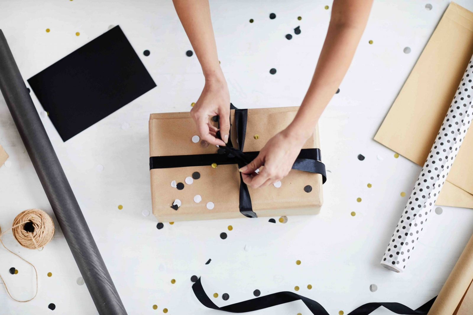 An above shot of gold, black, and white gift wrapping. Photo courtesy pressmaster/Fotolia.