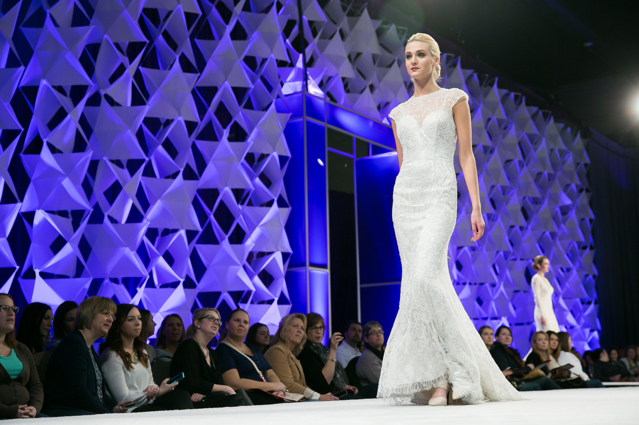A model walking down the runway at the Twin Cities Bridal Show. Photo by Lauren B Photography, courtesy The Wedding Guys.