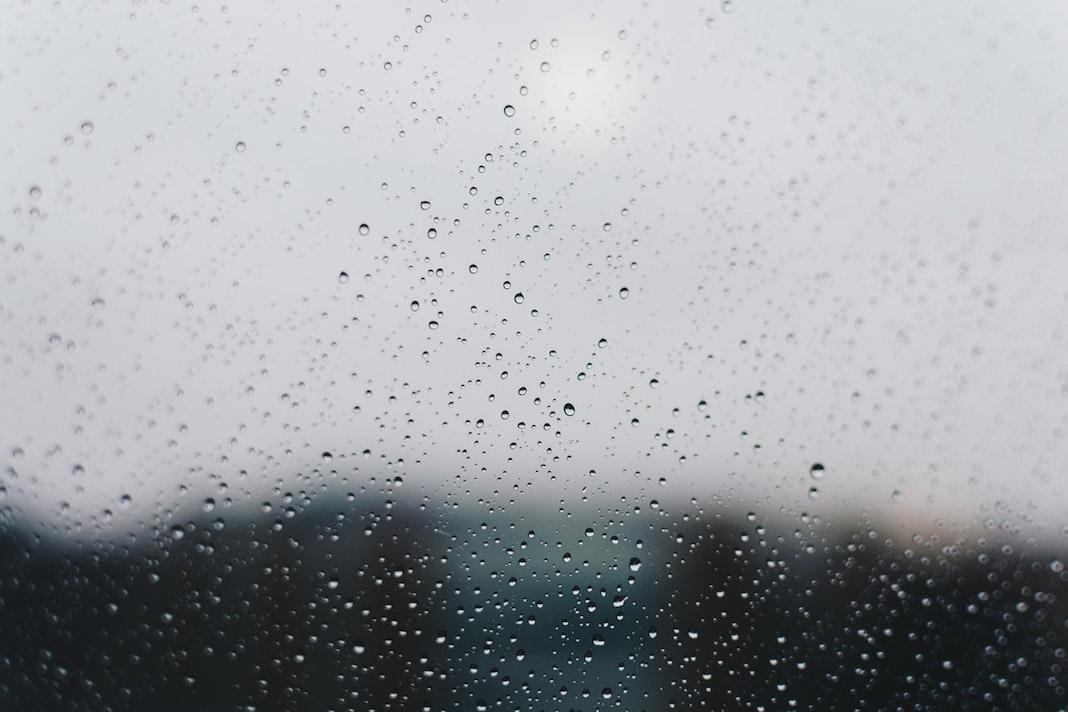 Photo of close up of raindrops on window