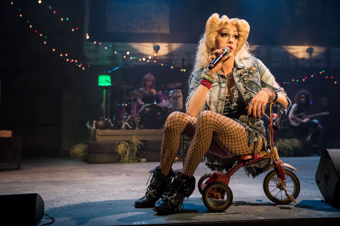 Tyler Michaels King dressed as Hedwig, on a tricycle.
