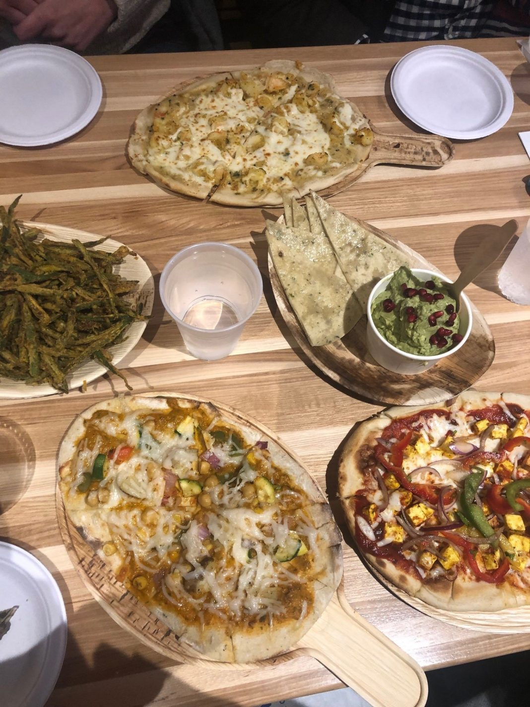 A spread of naan pizzas at Pizza Karma