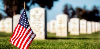 an American flag in cemetery