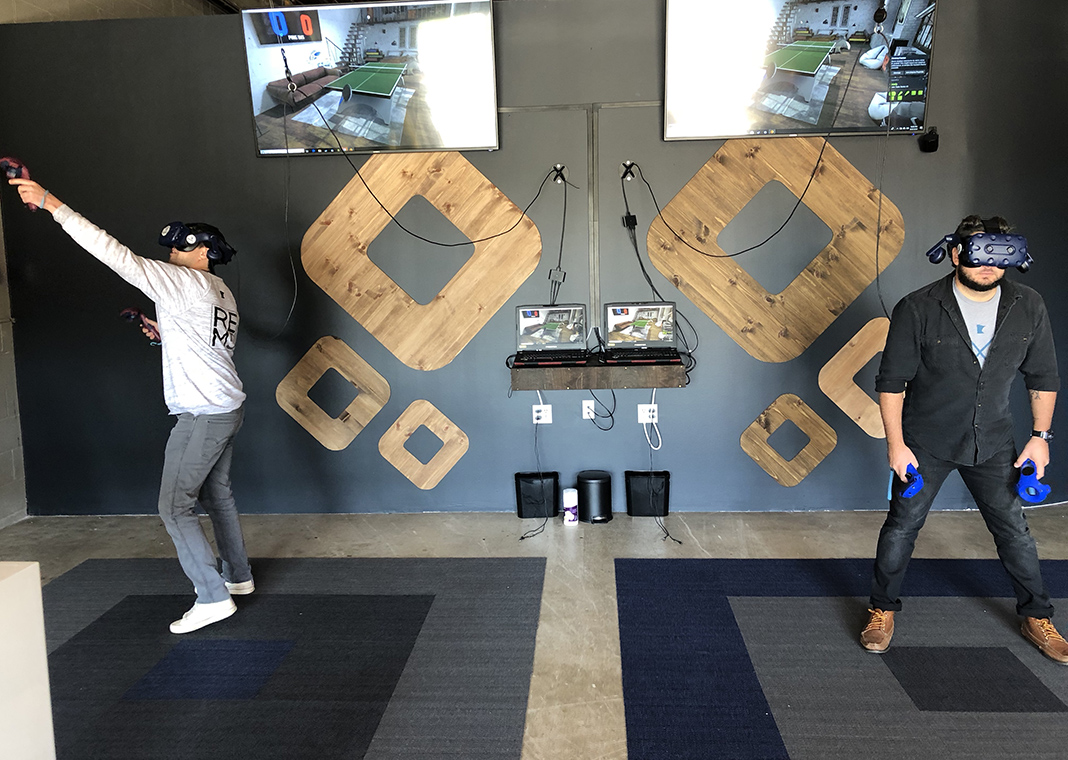 Photo of head-to-head ping pong game at REM5 Virtual Reality Laboratory.