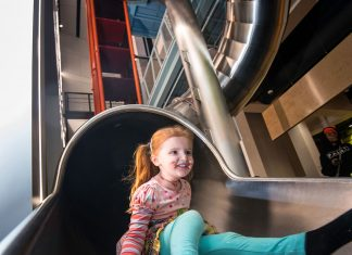 Photo of child on slide