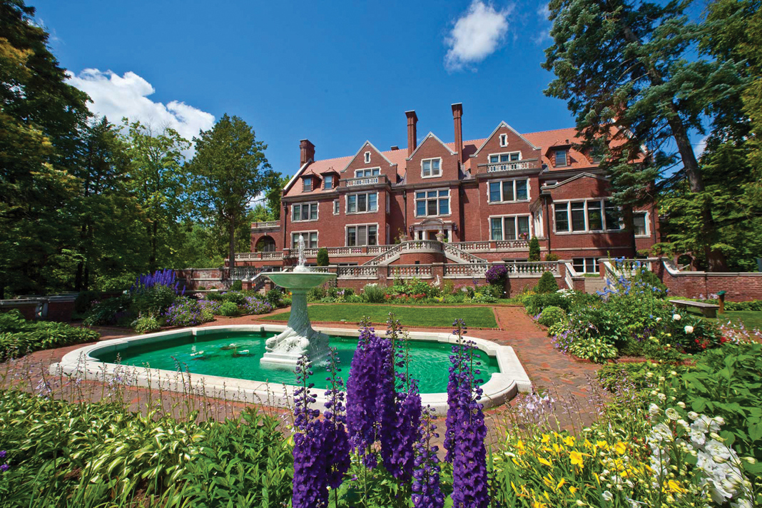 Large courtyard with water feature and gardens at the Glensheen Mansion gardens