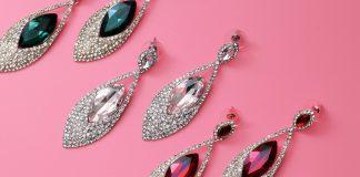 An array of jeweled earrings by motah/Unsplash