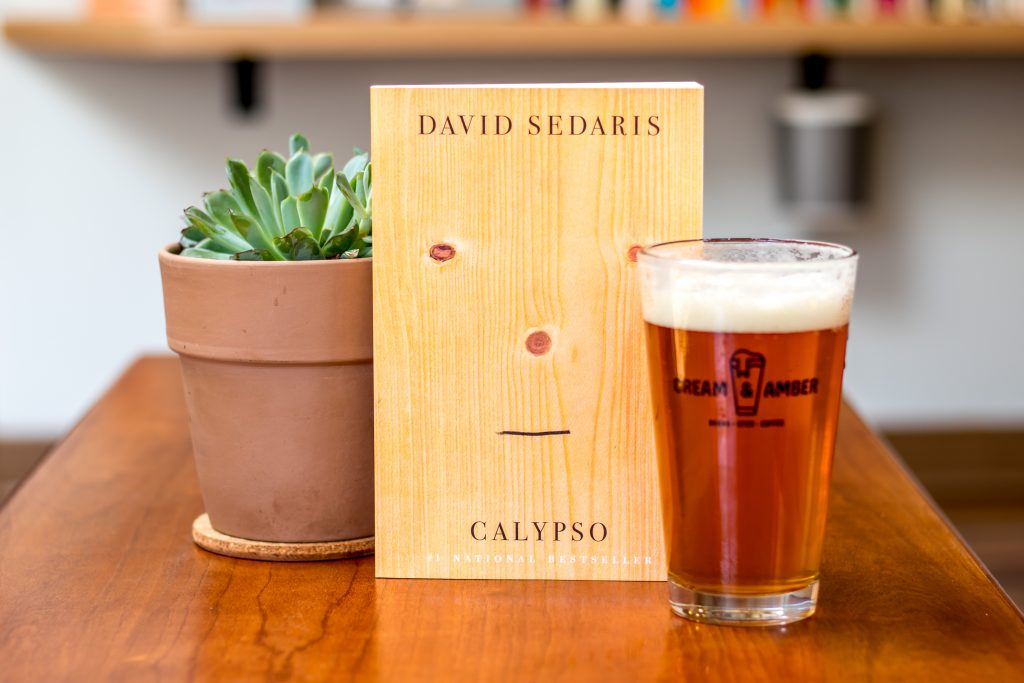 Image of Succulent, Calypso by David Sedaris book and Peach Bum IPA from Indeed