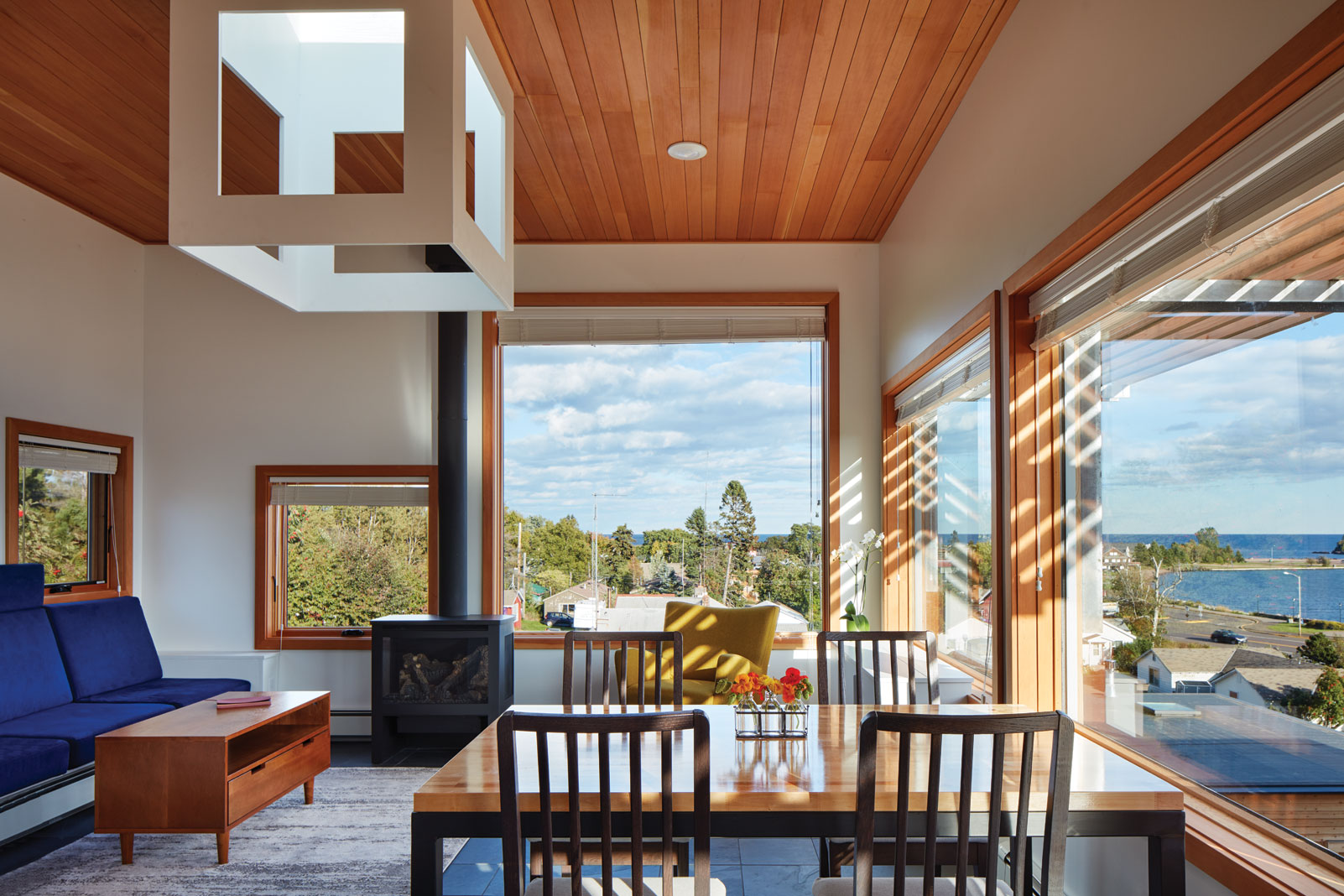 The upper level of each Tre Søstre dwelling has a skylight and large windows that bathe the room in natural light and harbor beauty