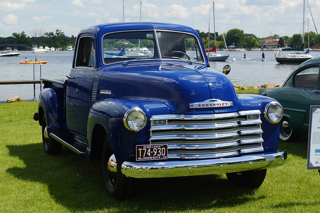 Photo of blue truck in front of lake