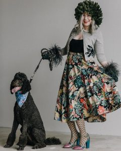 Jahna Peloquin with peacock accents and a poodle