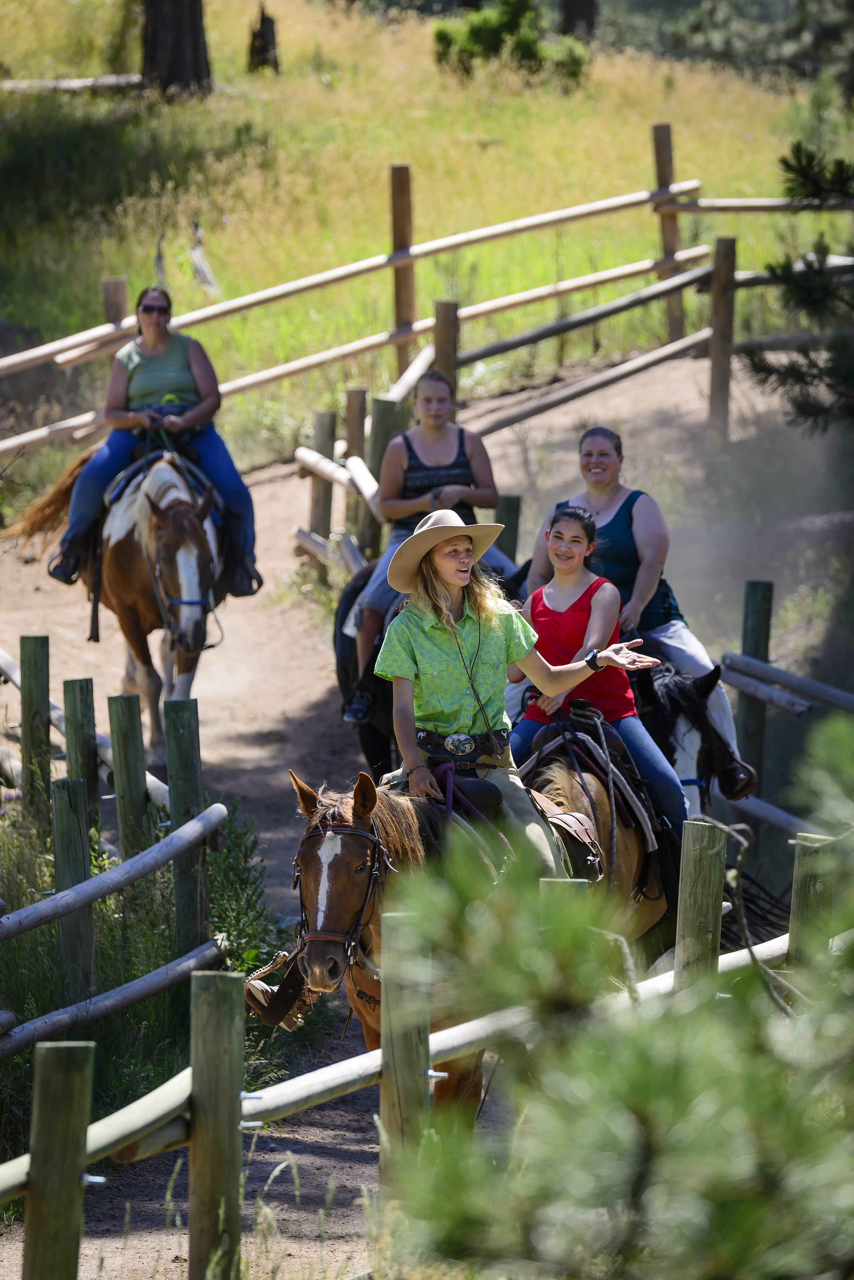Group of people on horseback, riding on Palmer Gulch Trail in Custer State Park