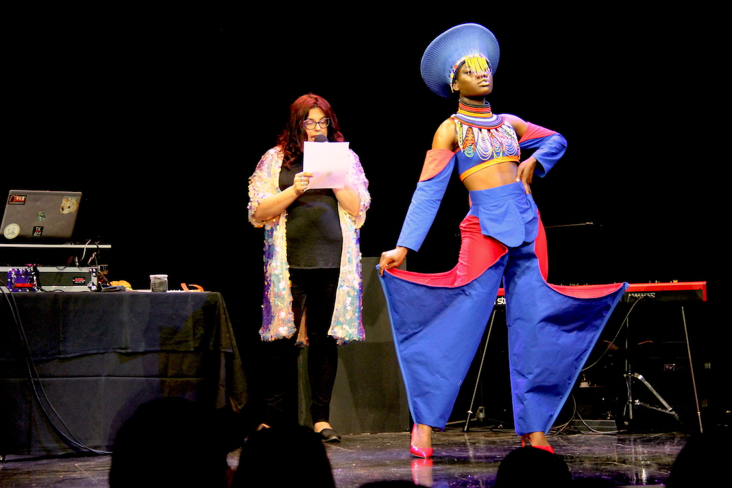 Dutchess Bijoux models Victor Molubah Farmah's design for DesignICON 2, a blue and red two-piece with traditional beadwork and statement pant legs