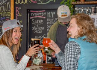 Two girls cheers over beers at Goat Ridge Brewery in Willmar Lakes