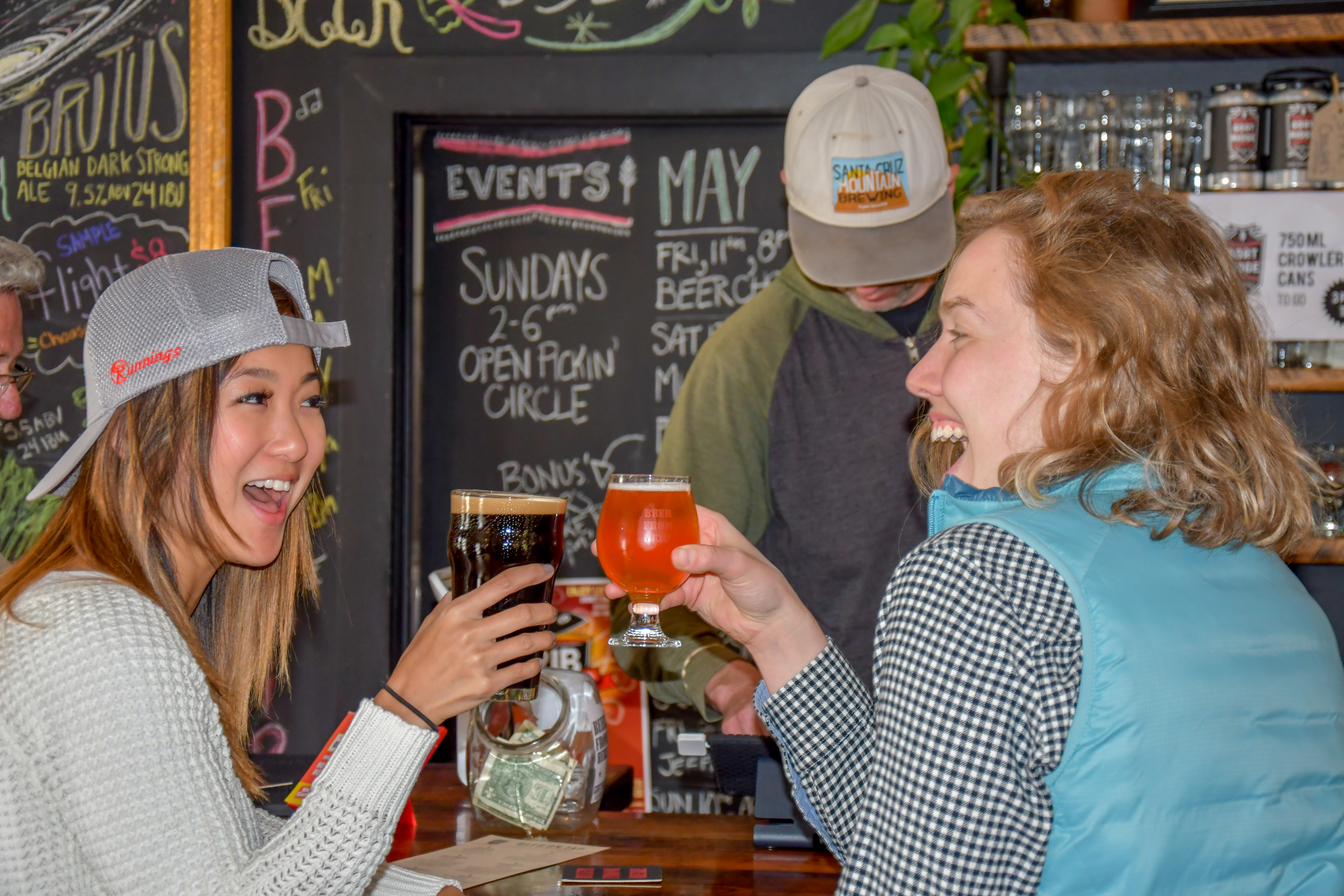 Two girls cheers over beers at Goat Ridge Brewing Co. in the Willmar Lakes Area