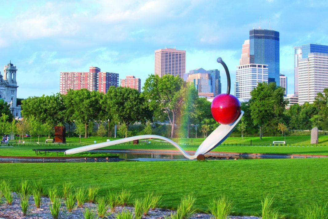 """Claes Oldenburg and Coosje van Bruggen Spoonbridge and Cherry 1985-1988 aluminum, stainless steel, paint 354 x 618 x 162"""" overall Collection Walker Art Center, Minneapolis Gift of Frederick R. Weisman in honor of his parents, William and Mary Weisman, 1988 Art © Claes Oldenburg and Coosje van Bruggen"""