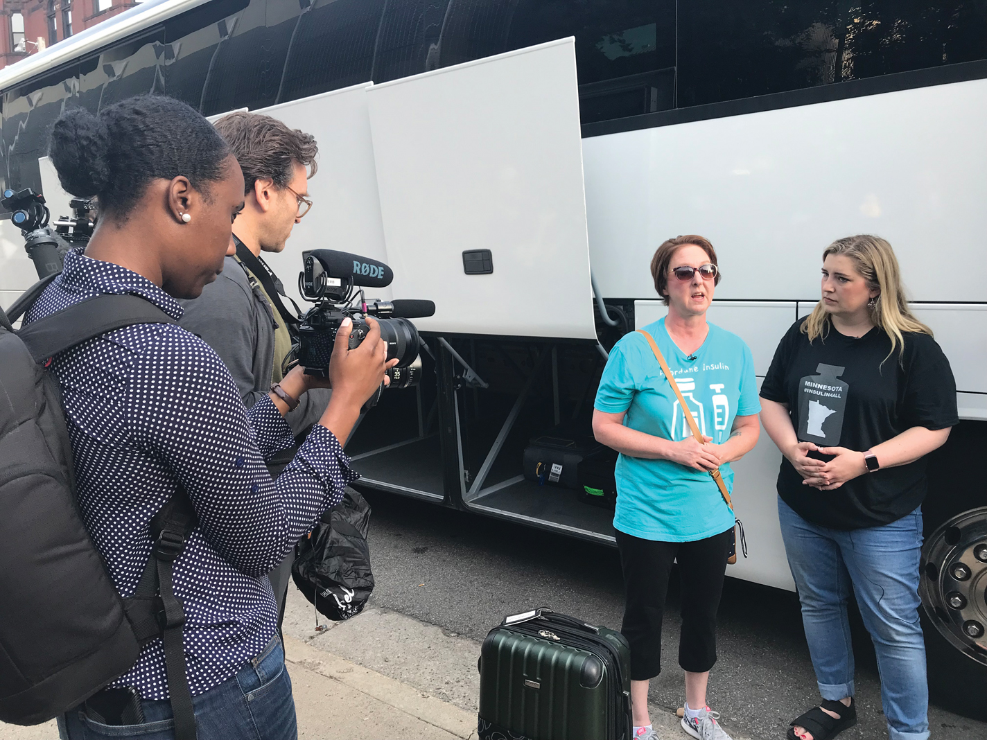 From left: Two identical bottles of insulin (U.S. on the left, Canadian on the right); Nicole Smith-Holt (blue shirt) and Quinn Nystrom (black shirt) speak to the media before leaving Minnesota