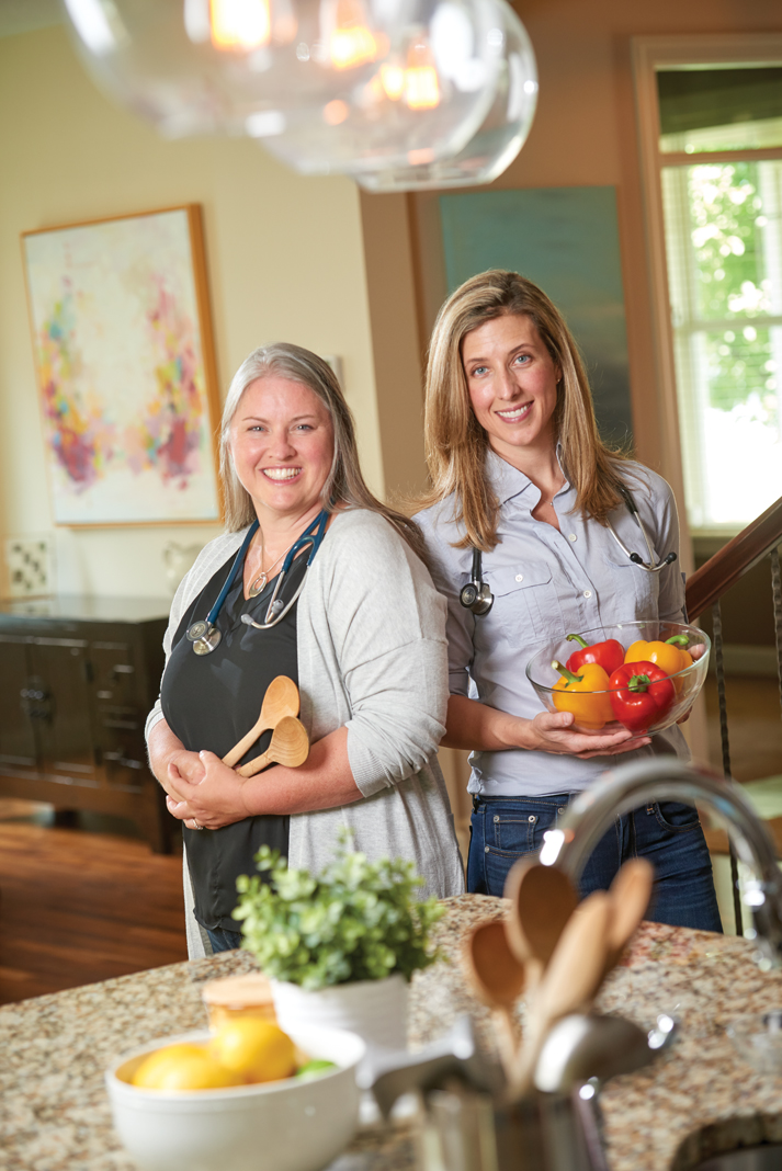 From Left: Lane Patten and Holly Schrupp Berg in Berg's home kitchen