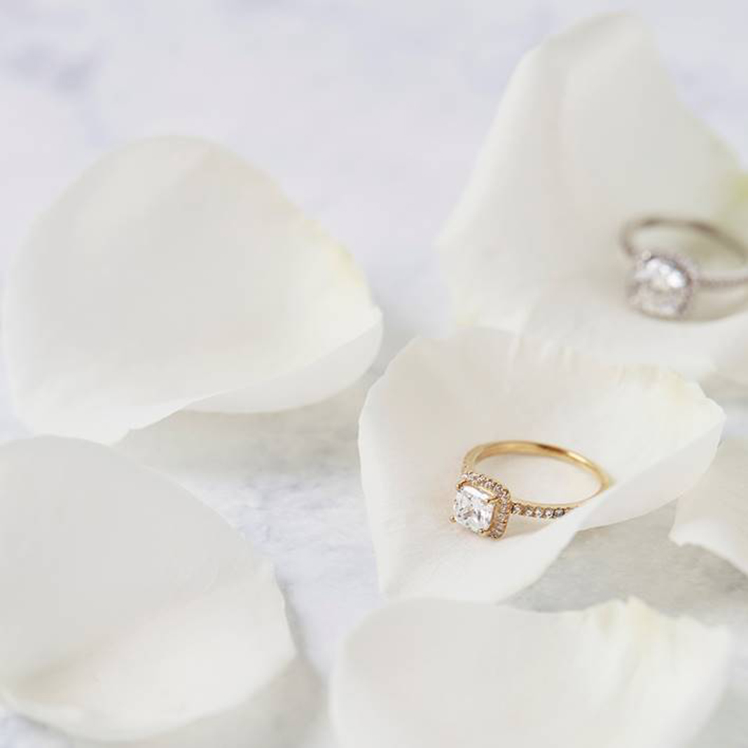 Diamond engagment rings on flower petals