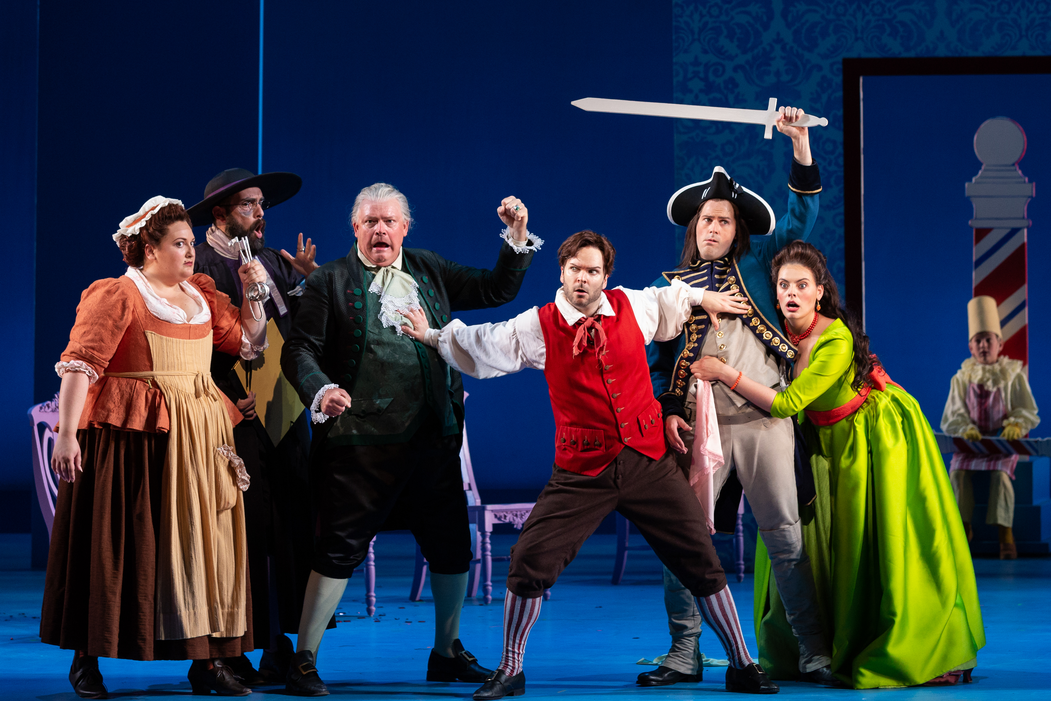 Actors on stage at the Minnesota Opera, performing The Barber of Seville.