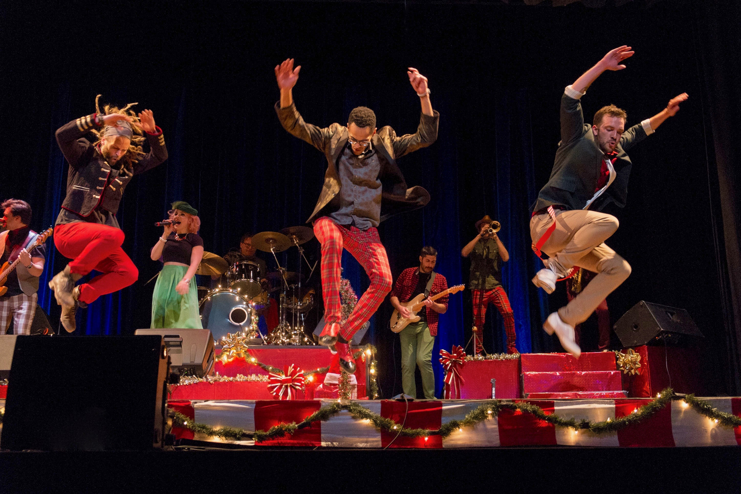 Cast of Rhythmic Circus dance on stage at the Ames Center