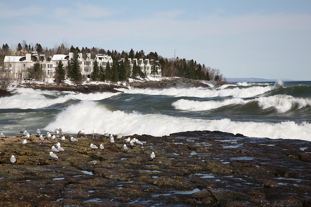 A resort on Lake Superior with big waves crashing to shore