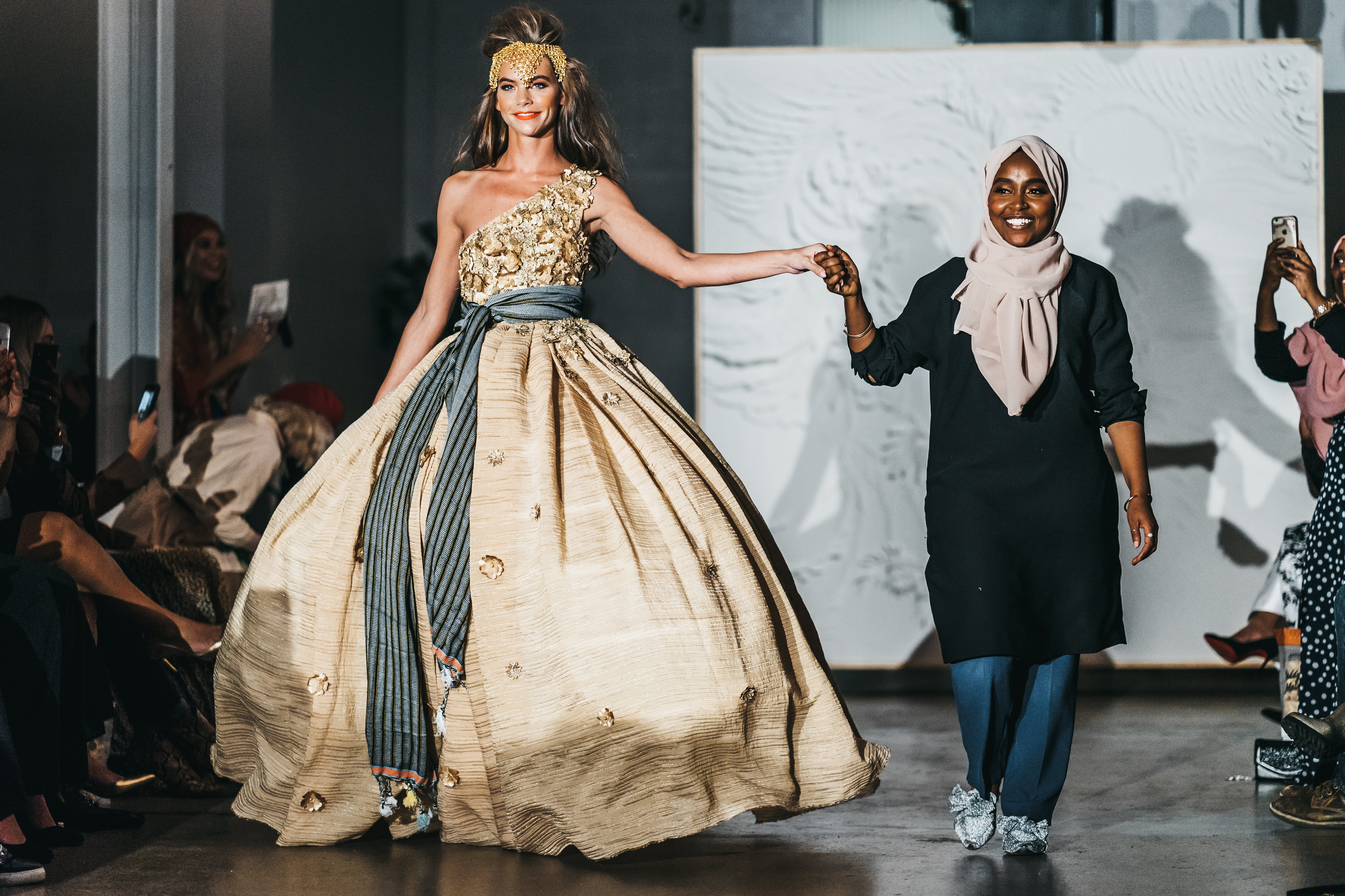 Model Hannah Peltier brings out designer Ramadhan Mohamed at Warm Winter Nights in Finfine