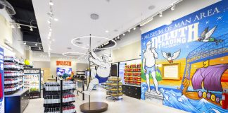 Duluth Trading Co.'s Mall of America store with Buck on the pole and an Adam Turman mural