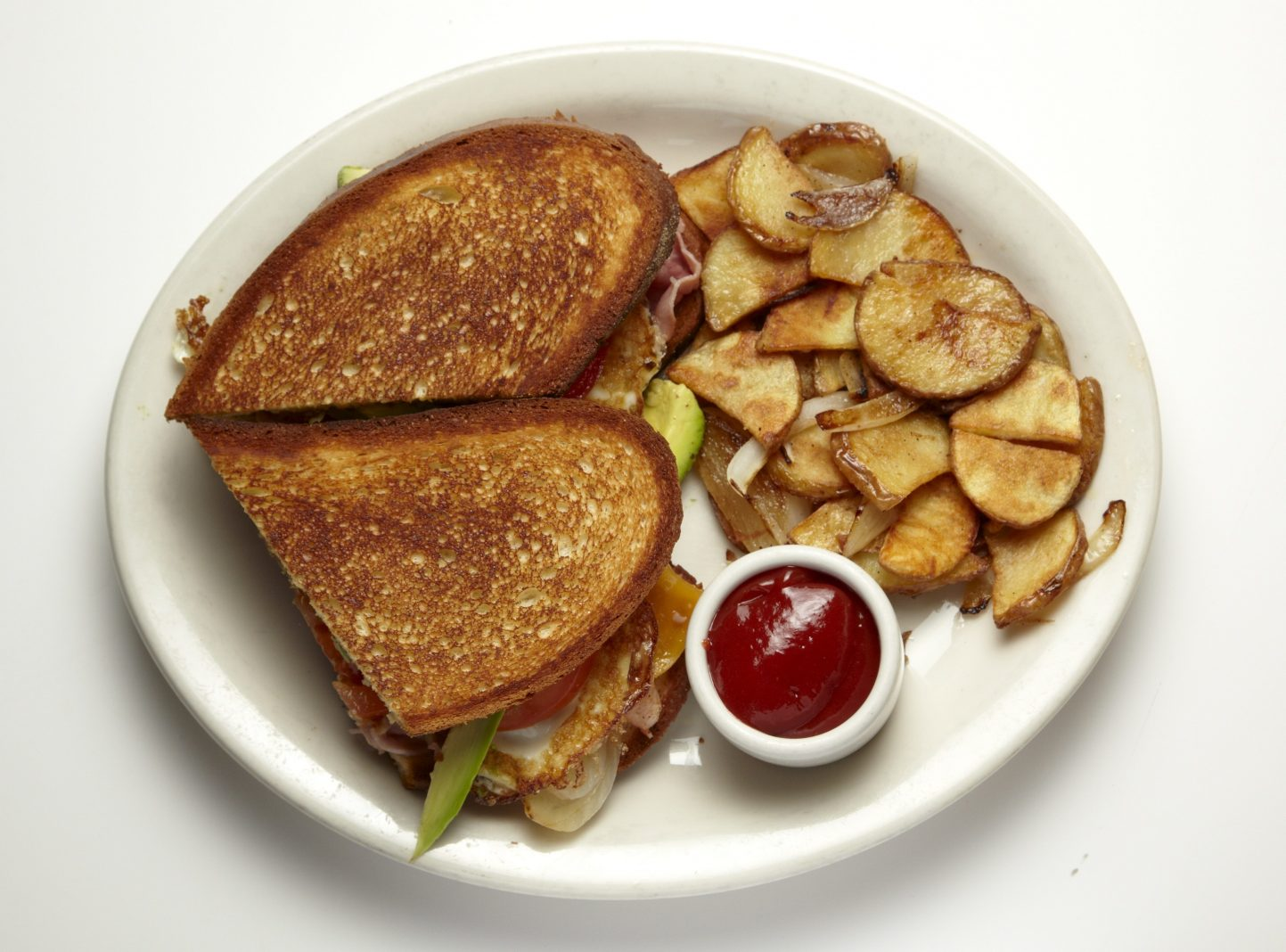 All-day breakfast: Iggy's Fried Egg Sandwich with GDC potatoes at Good Day Cafe