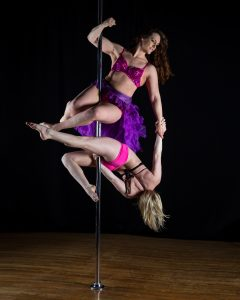 Myss Angie (above) and Dakota Wolfe on a dance pole.
