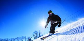 Male skier going down a ski hill in Minnesota