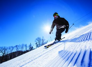 Male skier going down a ski hill in Minnesota
