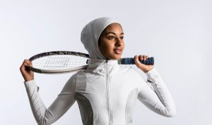 A tennis player using an Asiya sports hijab