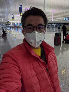 Yulin Yin taking precautions at the airport after flying to Wuhan, China, just as news of the novel coronavirus broke