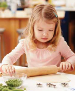 Little helpers can roll out pasta dough on a clean, floured surface