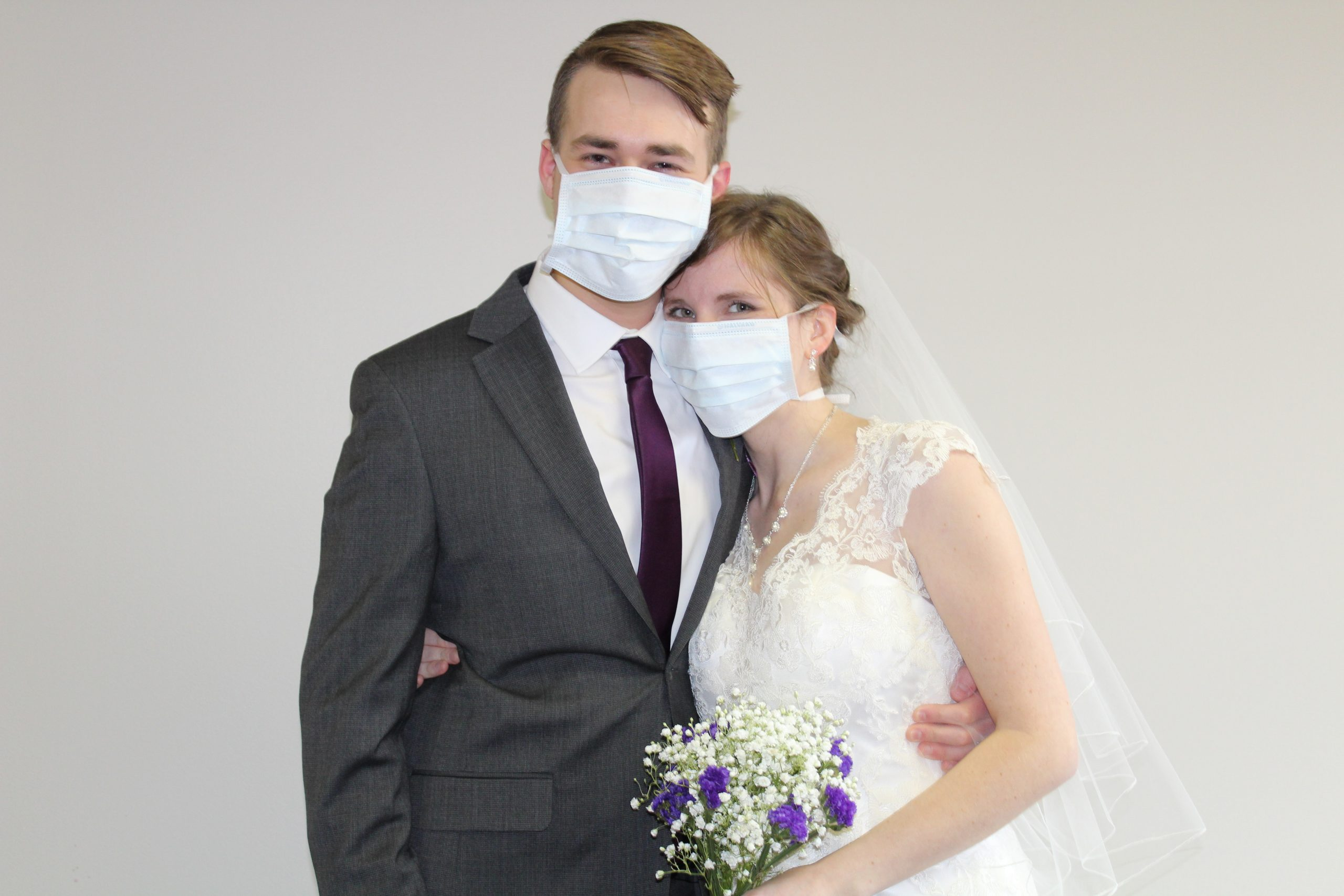 Sam and Emma Johnson with face masks on