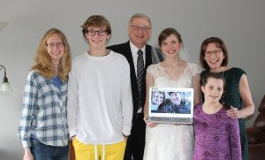 A family photo back at home with some Skyped-in members: Both Emma and Sam are excited to share the special day they planned with their siblings once things are safer.