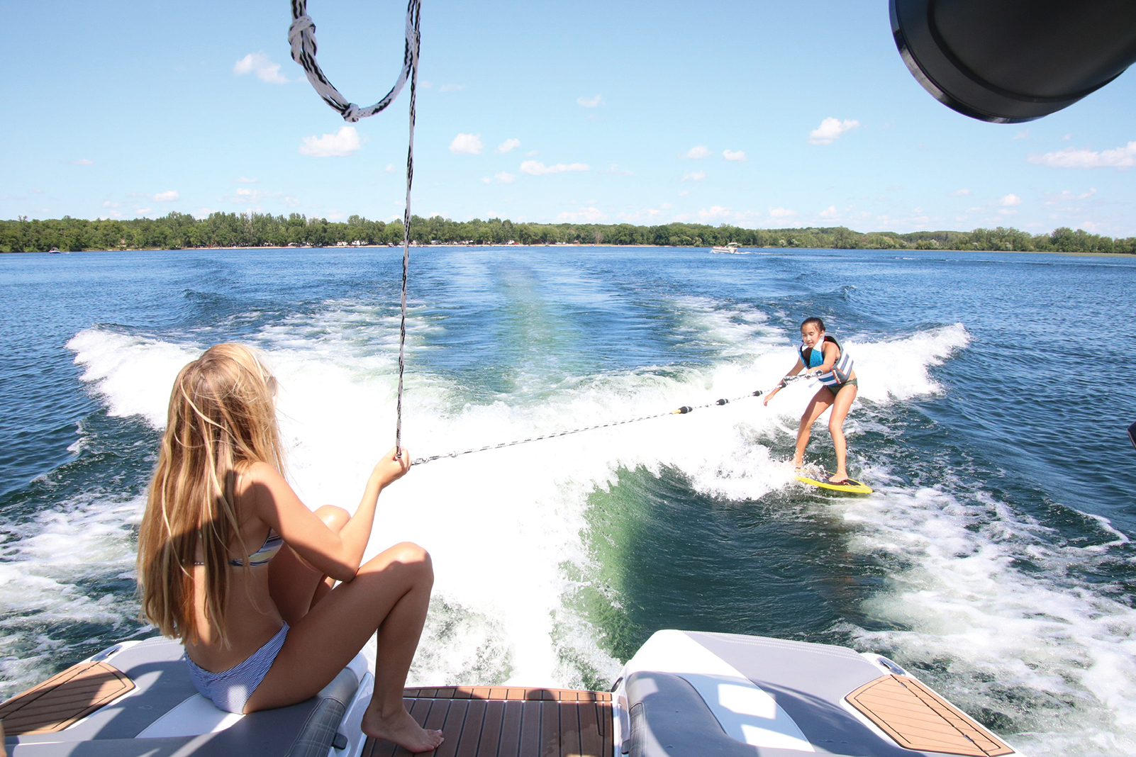 Hangloose MN specializes in wakesurfing and paddle boarding rentals and classes on Lake Carlos