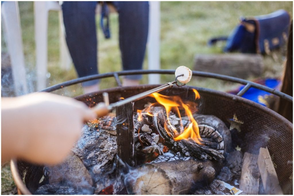 Image of roasting a marshmallow over campfire