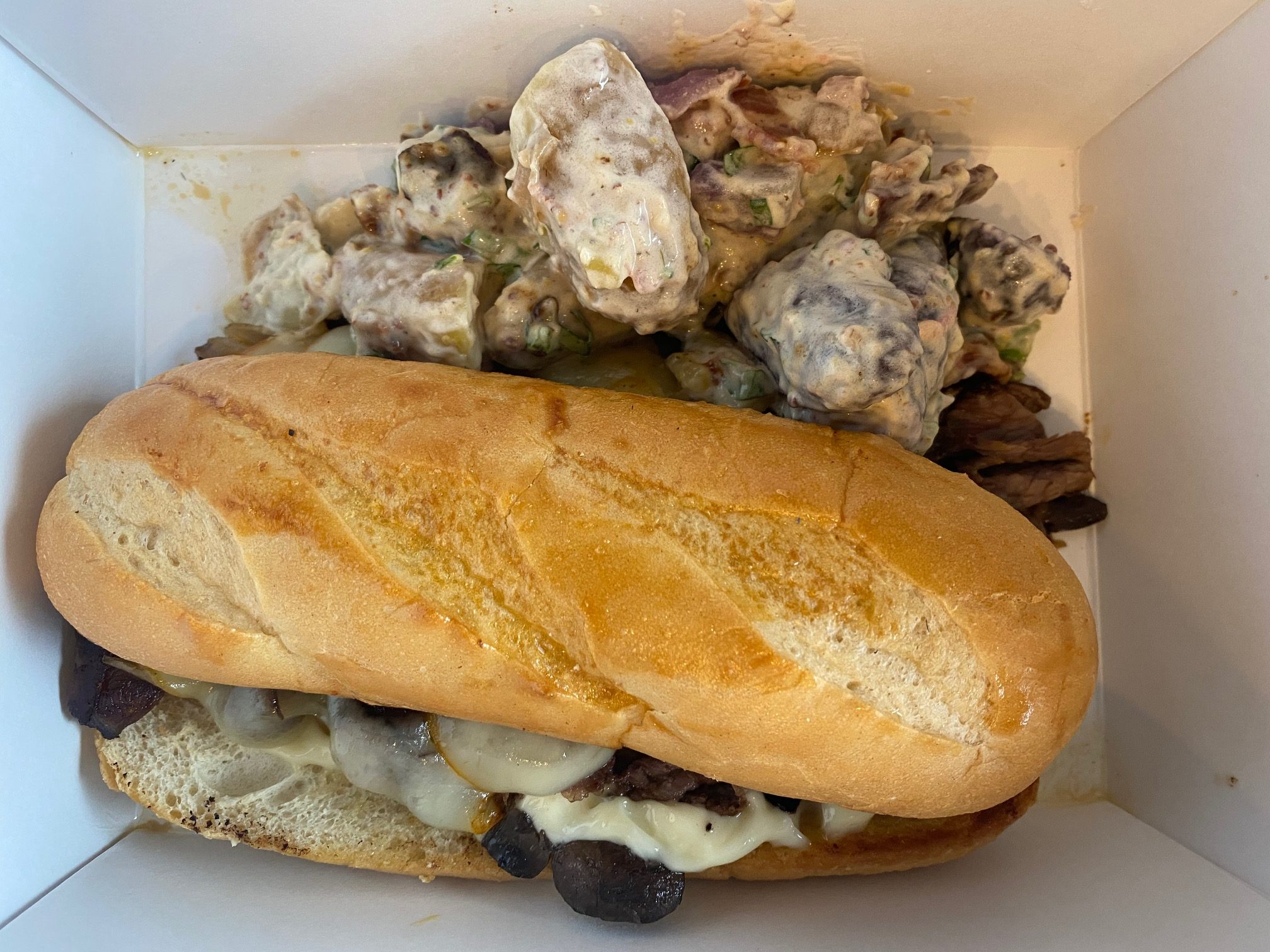The French dip with bacon potato salad