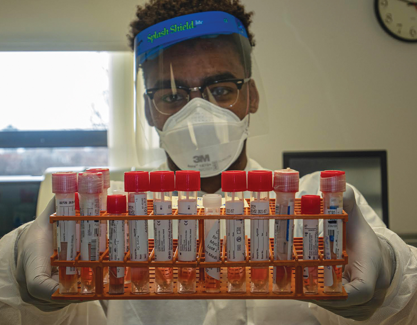 Hennepin Healthcare: Medical Technologist Khadel King with samples to be tested for COVID-19 in Hennepin Healthcare's microbiology lab.