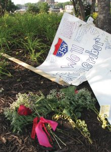 Homemade sign at a temporary memorial site