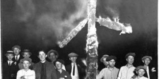 The KKK burning a cross.