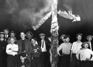 The KKK burning a cross.