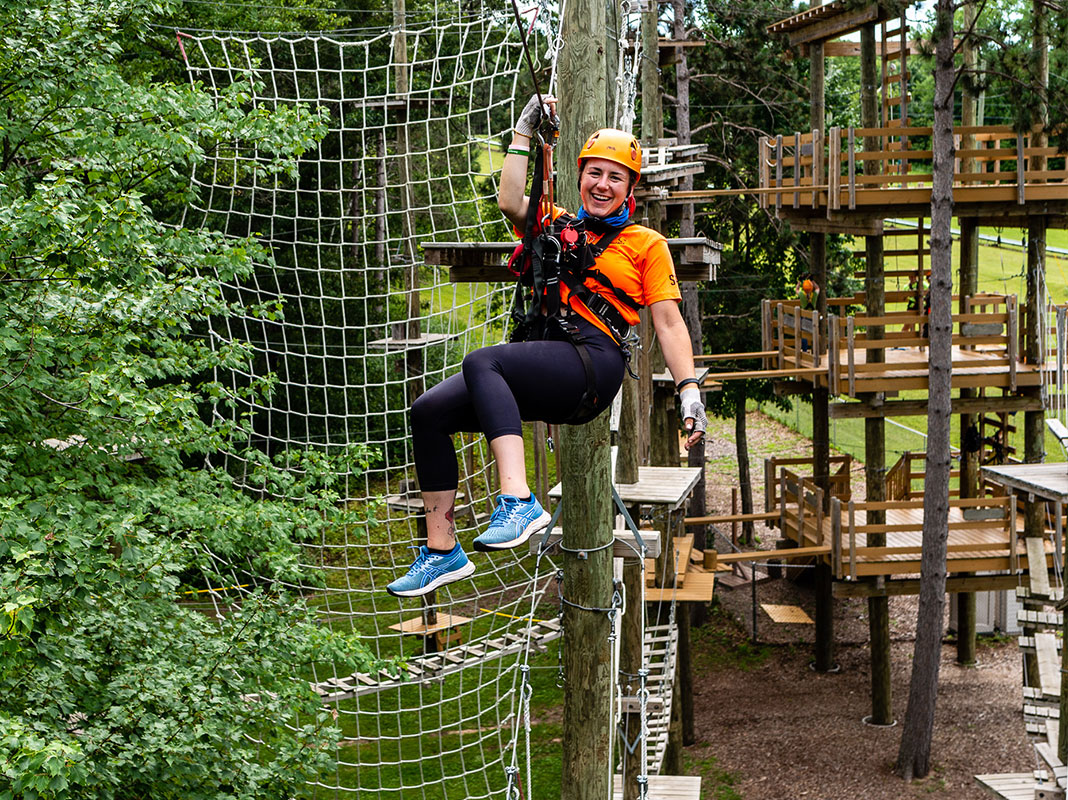 Woman zip lining at Trollhaugen Adventure Park