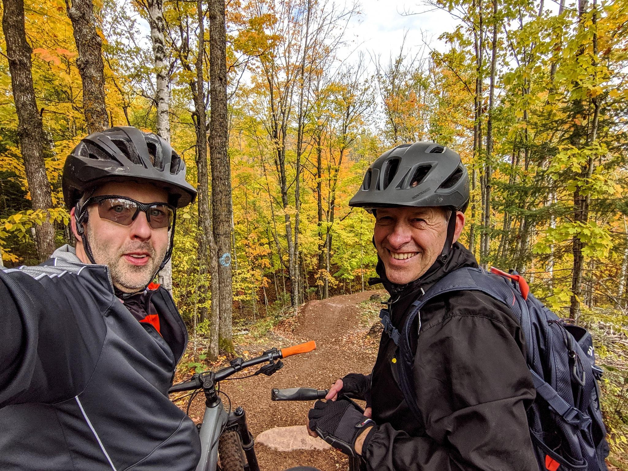 Two men biking at Tioga Recreation Area in Grand Rapids in fall