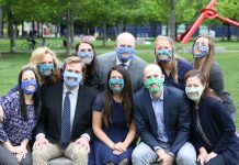Audiology Concepts staff sitting outside wearing clear face masks