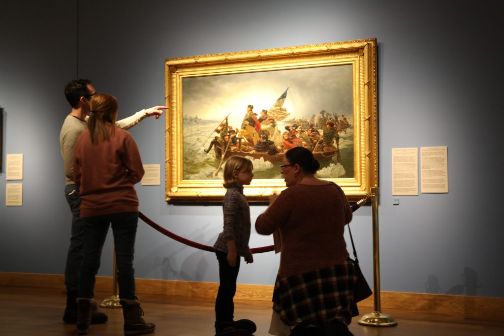 Guests at Minnesota Marine Art Museum look at Washington Crossing the Delaware painting